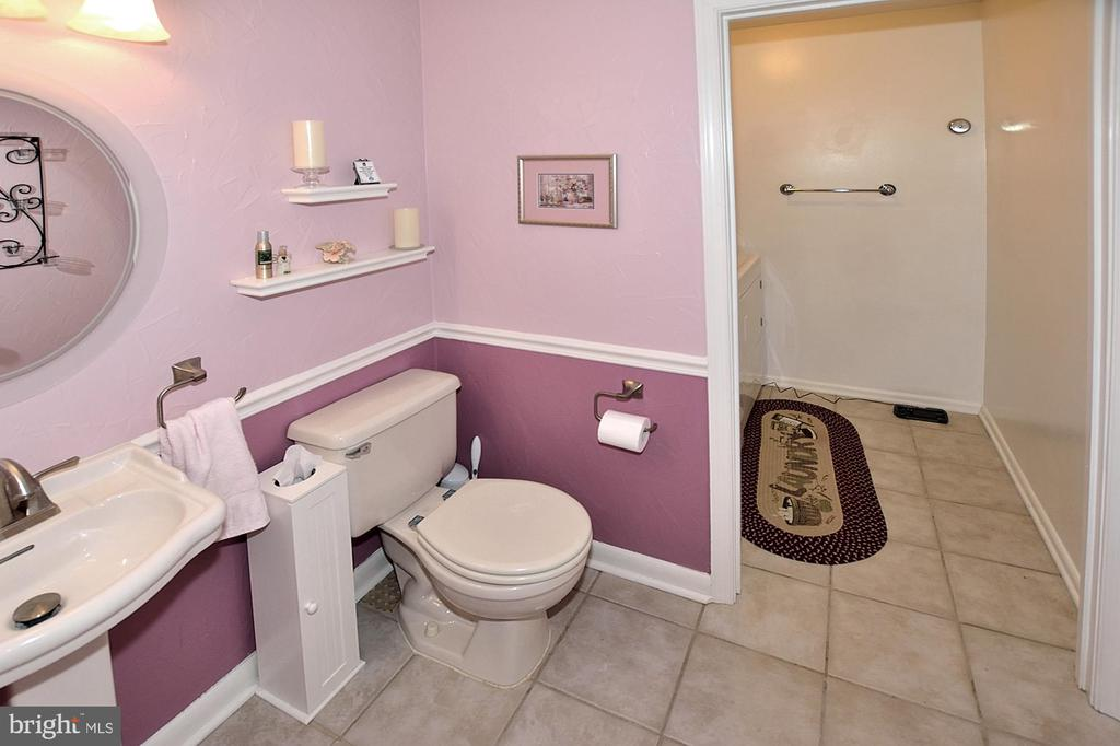 Half bath connected to the laundry room - 15700 CRANBERRY CT, DUMFRIES