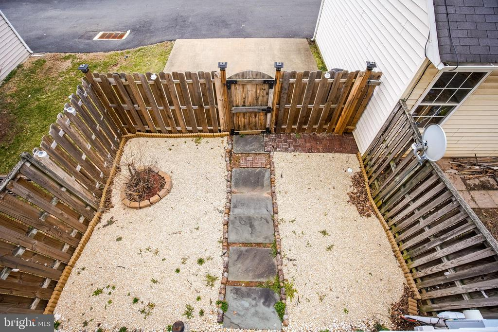 Outdoor space with parking view - 22960 REGENT TER, STERLING