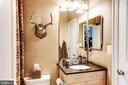 Bedroom 4 en-suite bath w/ leather walls. - 208 MCHENRY ST SE, VIENNA