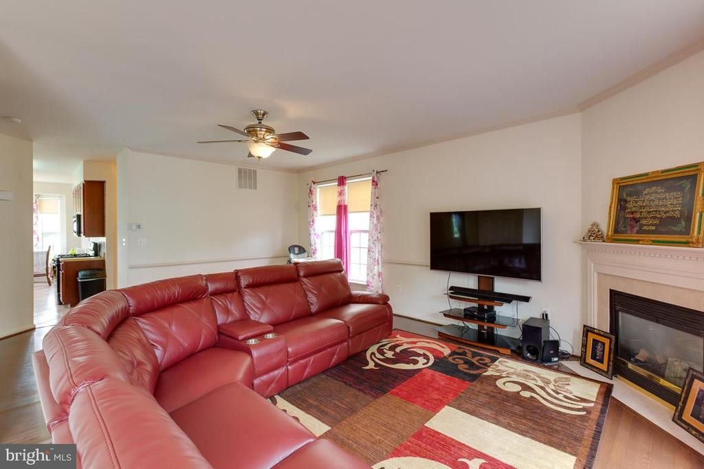 Living Room With A Gas Log Fireplace - 13169 THRIFT LN, WOODBRIDGE