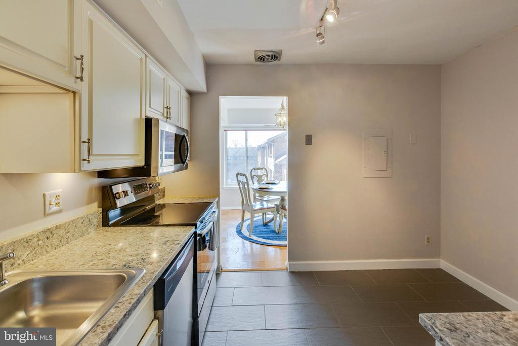 Updated kitchen with granite counters - 11423 COMMONWEALTH DR #301, ROCKVILLE
