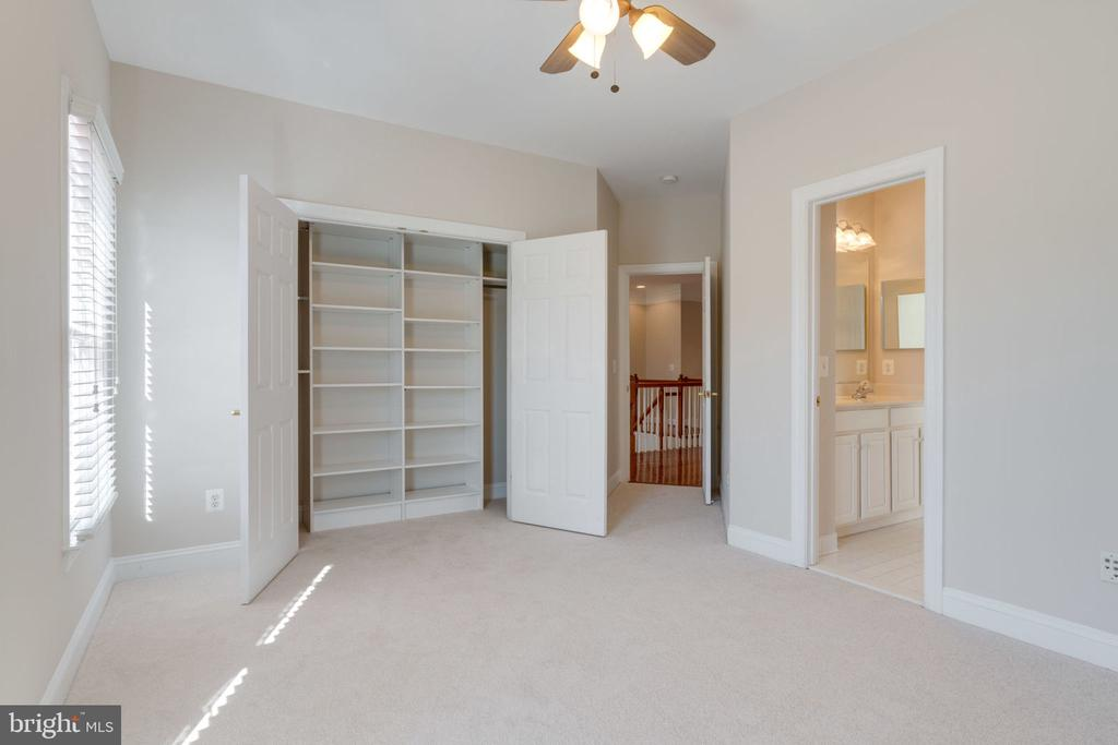 Bedroom with built-in shelving - 9004 ADAMS CHASE CIR, LORTON