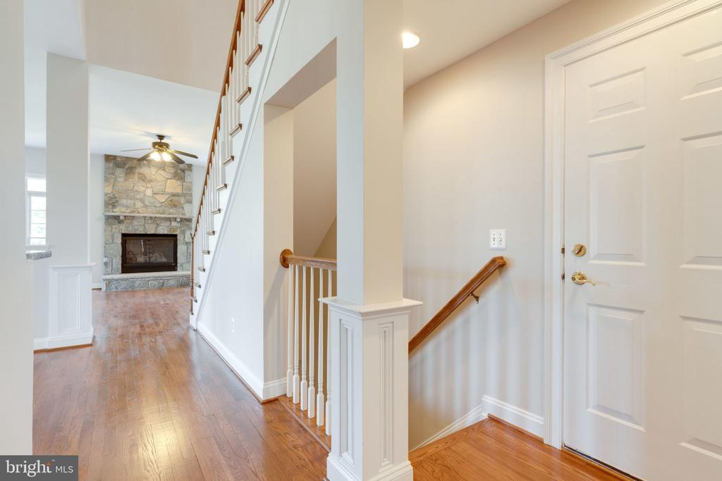 Hall leading to family room. - 9004 ADAMS CHASE CIR, LORTON