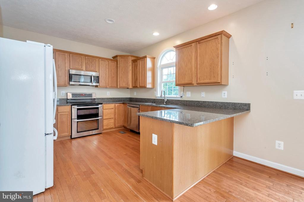 kitchen with granite countertops - 4111 DERBYSHIRE LN, FREDERICKSBURG