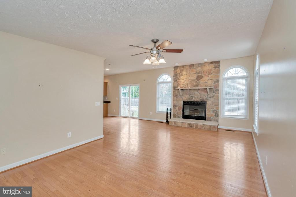 Family Room with wood burning stone fireplace - 4111 DERBYSHIRE LN, FREDERICKSBURG
