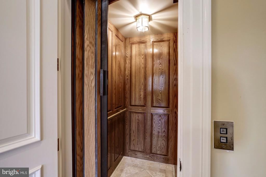 Wood paneled Elevator services all levels - 886 CHINQUAPIN RD, MCLEAN