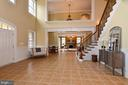 Light filled two story foyer with gorgeous tile - 12794 YATES FORD ROAD, CLIFTON