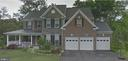 Stone and brick front with side porch - 8901 TITLEIST TRL, LORTON