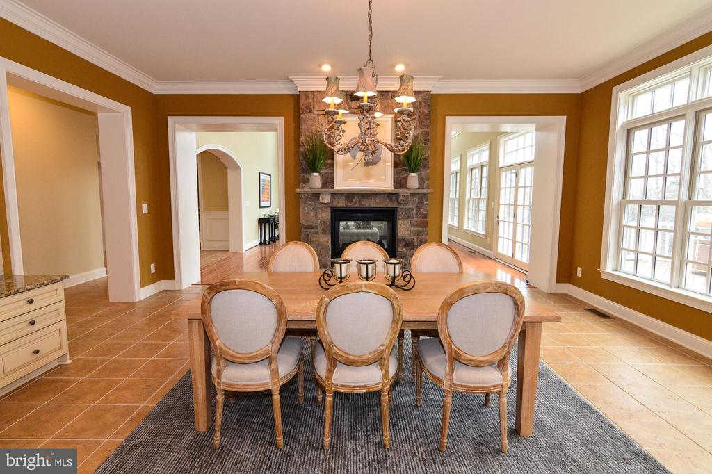 Beautiful chandelier above kitchen table - 12794 YATES FORD ROAD, CLIFTON