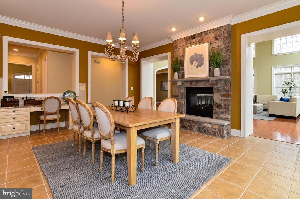 Inviting dining area next to cozy fireplace - 12794 YATES FORD ROAD, CLIFTON