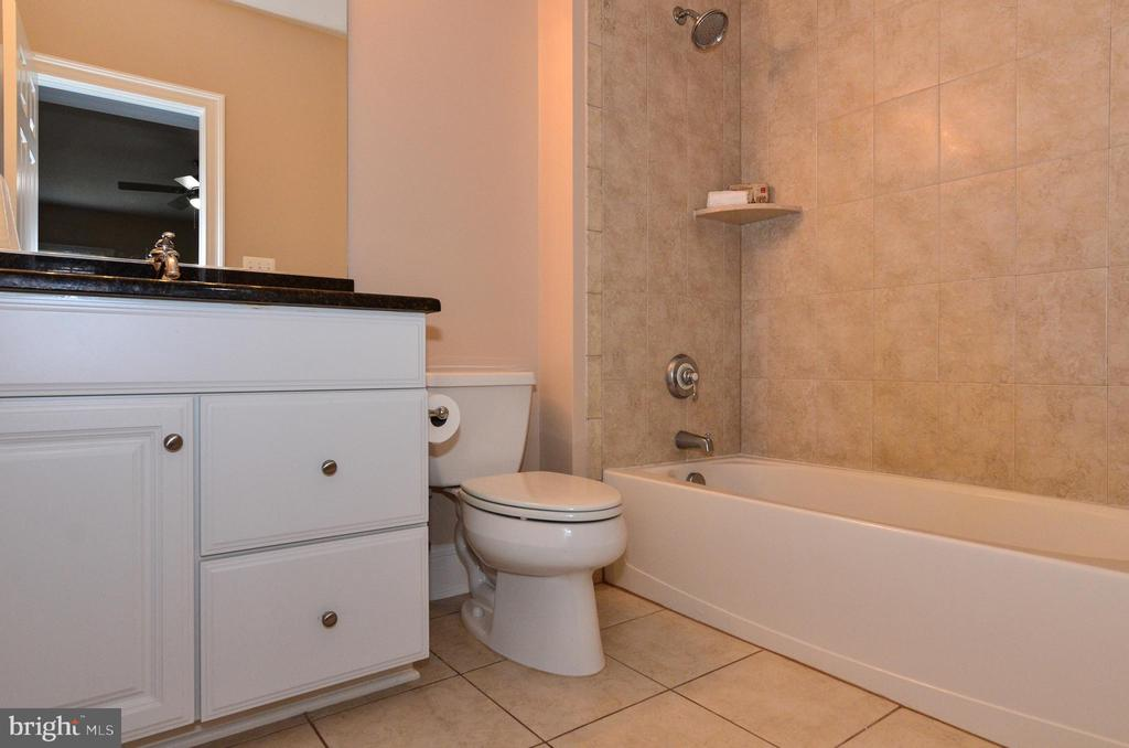 En-suite bath with granite counter next to bedroom - 12794 YATES FORD ROAD, CLIFTON