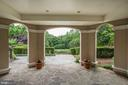 Stone terraces lead to the pool/spa area - 886 CHINQUAPIN RD, MCLEAN