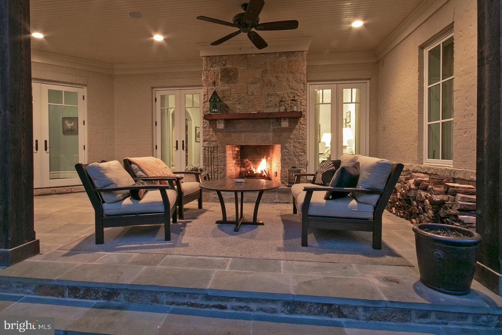 Wood burning fireplace on covered patio - 203 CARRWOOD RD, GREAT FALLS