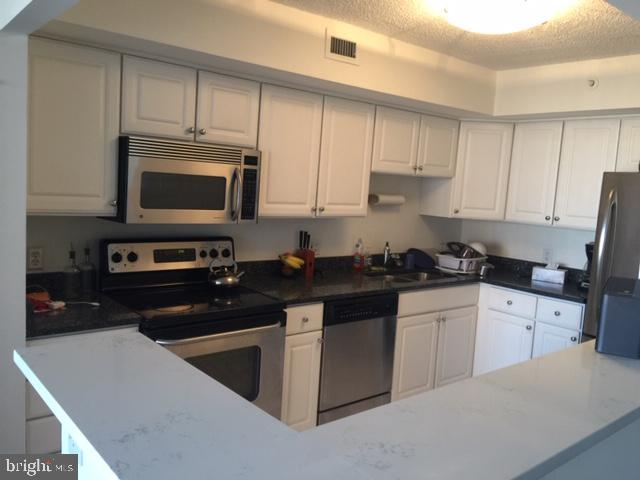 Kitchen with new Quartz Counter top - 2230 GEORGE C MARSHALL DR #1011, FALLS CHURCH
