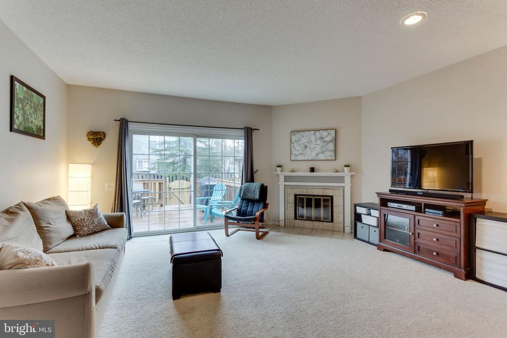 Living room with a fireplace and sliding doors - 7211 STOVER CT, ALEXANDRIA