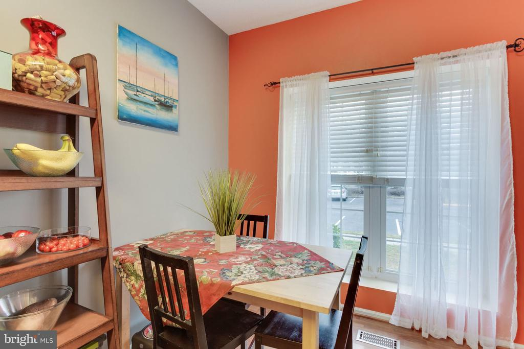Kitchen has a large window and eat-in area. - 7211 STOVER CT, ALEXANDRIA