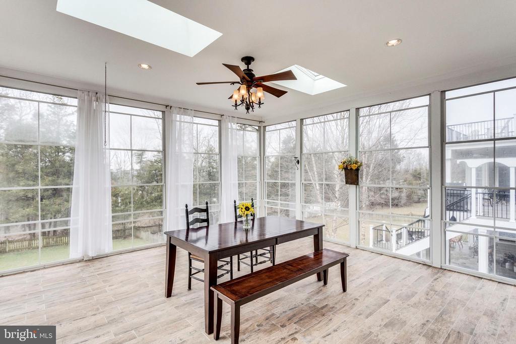3 season room features floor to ceiling windows. - 42744 RIDGEWAY DR, BROADLANDS