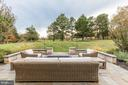 Rear Patio overlooking backyard and Golf course - 9801 BEACH MILL RD, GREAT FALLS