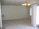 Living and dining areas as viewed from hallway - 125 S CLUBHOUSE DR SW #8, LEESBURG