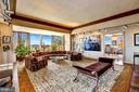Living room features pocket doors to adjacent DR - 10201 GROSVENOR #1701, NORTH BETHESDA