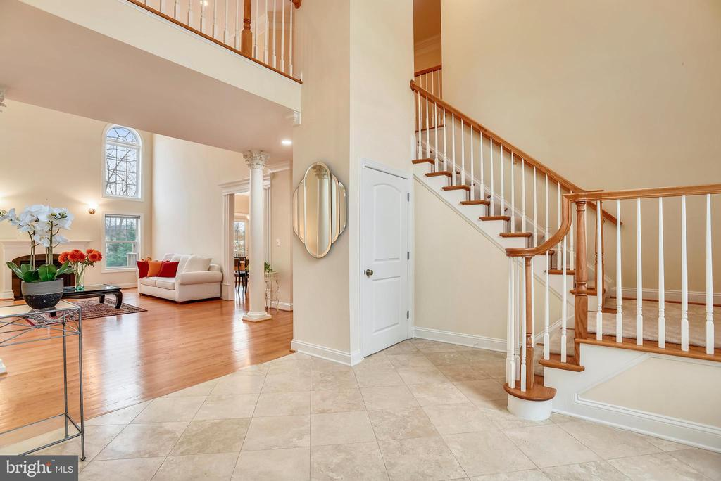 Foyer stairs to second floor and large entry. - 7919 N PARK ST, DUNN LORING