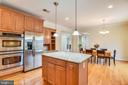 Island  with pendant lights. - 7919 N PARK ST, DUNN LORING