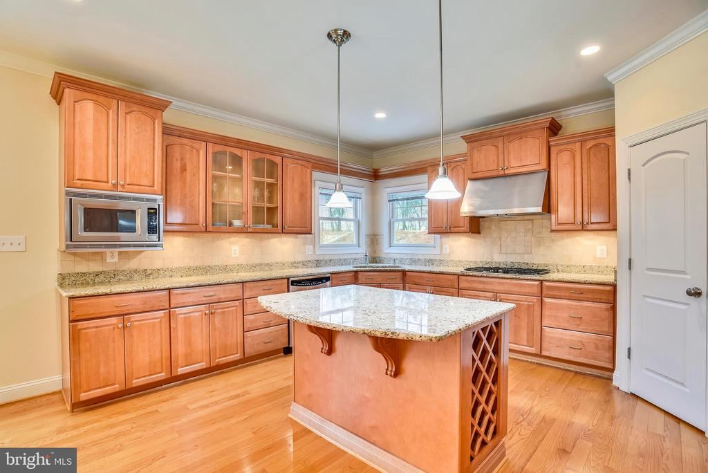 Spacious kitchen and island storage. - 7919 N PARK ST, DUNN LORING