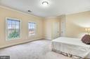 Large rear elevation bedroom with walk in closet. - 7919 N PARK ST, DUNN LORING
