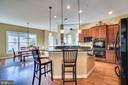 Open kitchen with eat in area - 18483 ORCHID DR, LEESBURG