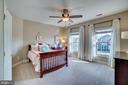 Bedroom 1 with private bath - 18483 ORCHID DR, LEESBURG