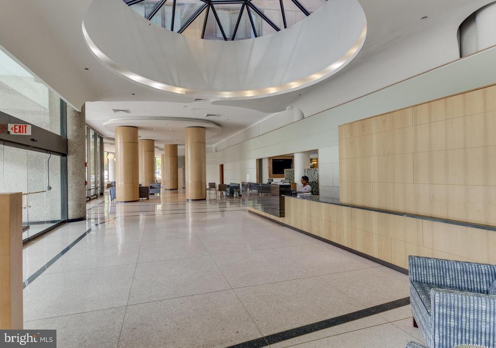 Modern Entry and Front Desk - 1300 CRYSTAL DR #PH3S, ARLINGTON