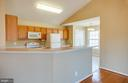 Kitchen overlooking table space - 8485 COLFAX DR, KING GEORGE