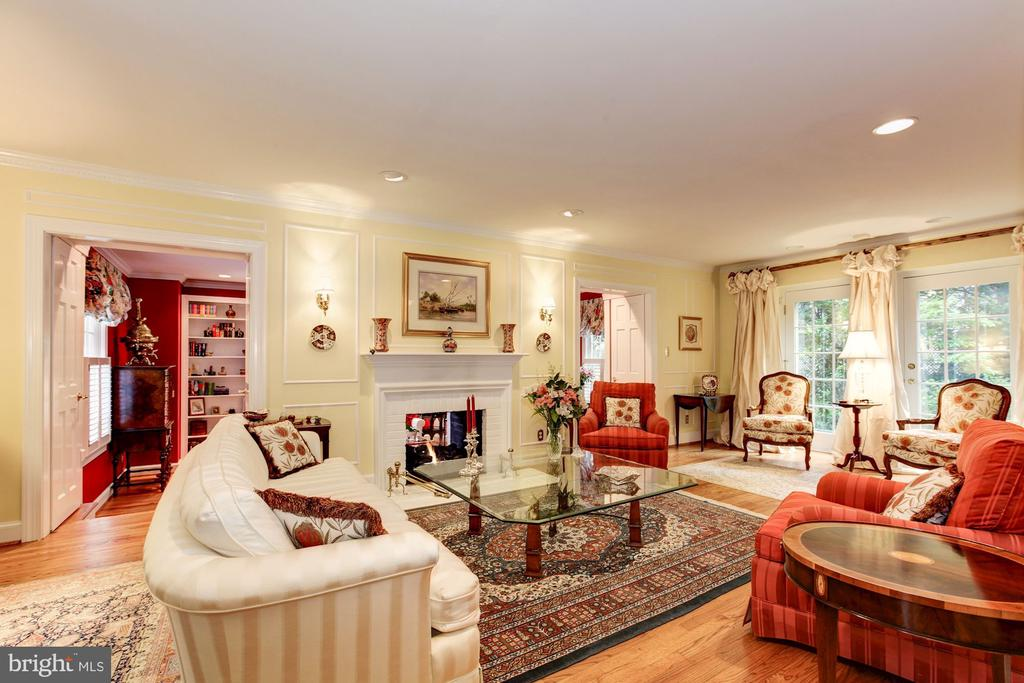 Gorgeous living room with two sided gas fireplace - 6008 KENNEDY DR, CHEVY CHASE