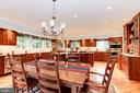 Kitchen flooded with light overlooking park - 6008 KENNEDY DR, CHEVY CHASE