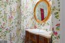 Beautiful powder room with wall mounted fixture - 6008 KENNEDY DR, CHEVY CHASE