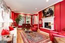 Family Room with built ins and two sided fireplace - 6008 KENNEDY DR, CHEVY CHASE