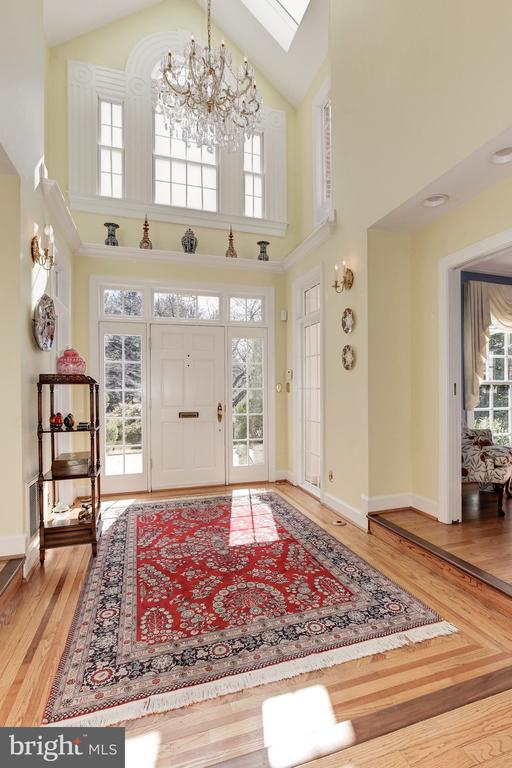 Light filled foyer w/ exquisite crystal chandelier - 6008 KENNEDY DR, CHEVY CHASE