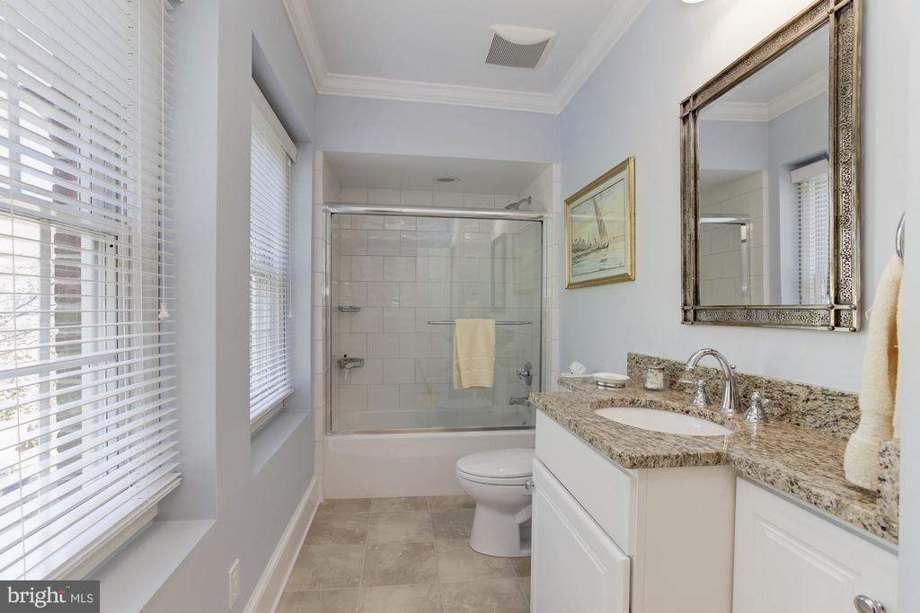 En suite 3rd bathroom w/ tub +  glass shower doors - 6008 KENNEDY DR, CHEVY CHASE