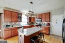 Island with Seating and Tiled Backsplash - 12157 CANTERBURY CT, KING GEORGE