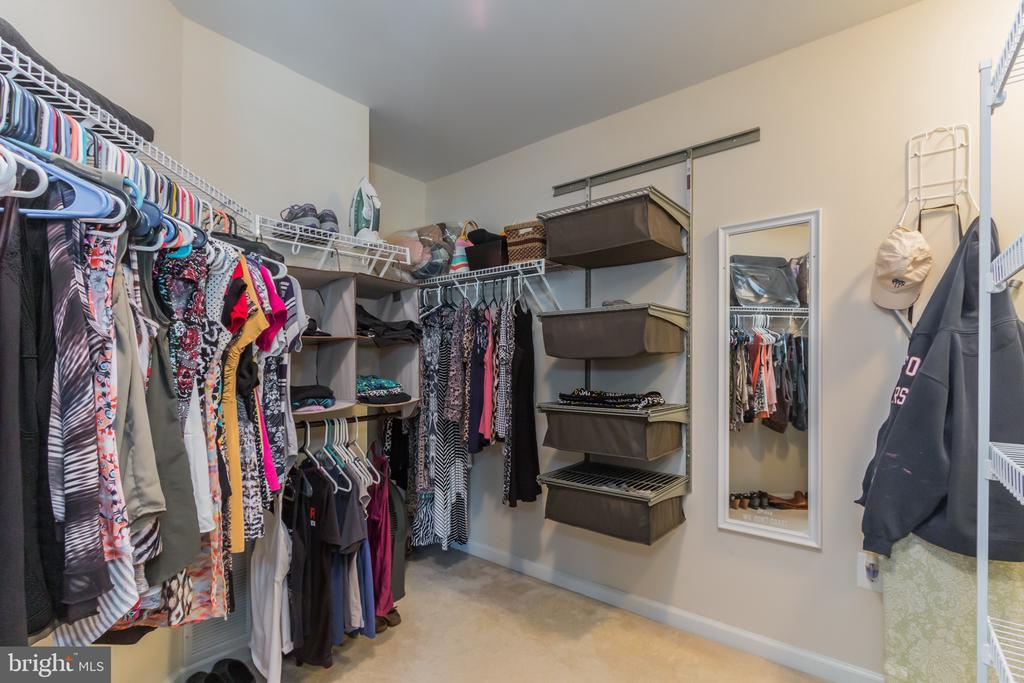 Master closet with separate his/hers areas - 23081 PECOS LN, BRAMBLETON