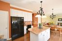 Kitchen opens to the sun filled family room - 18707 DRUMMOND PL, LEESBURG