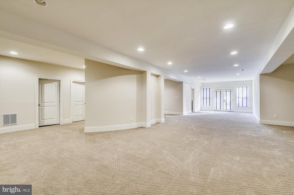 Lower Level Recreation Room w/exit to side yard - 9801 BEACH MILL RD, GREAT FALLS