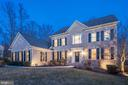 Exquisite exterior lighting highlights the home - 1309 SHAKER WOODS RD, HERNDON