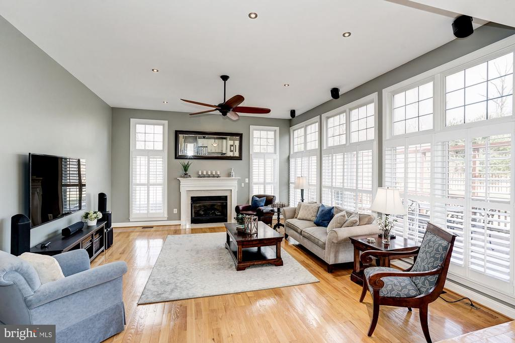 Adjoining family room off the kitchen w/ gas FP - 1309 SHAKER WOODS RD, HERNDON