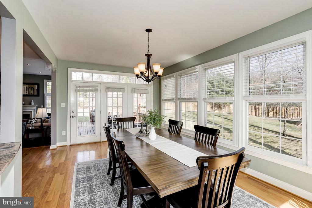 French door open to the deck and views of yard - 1309 SHAKER WOODS RD, HERNDON
