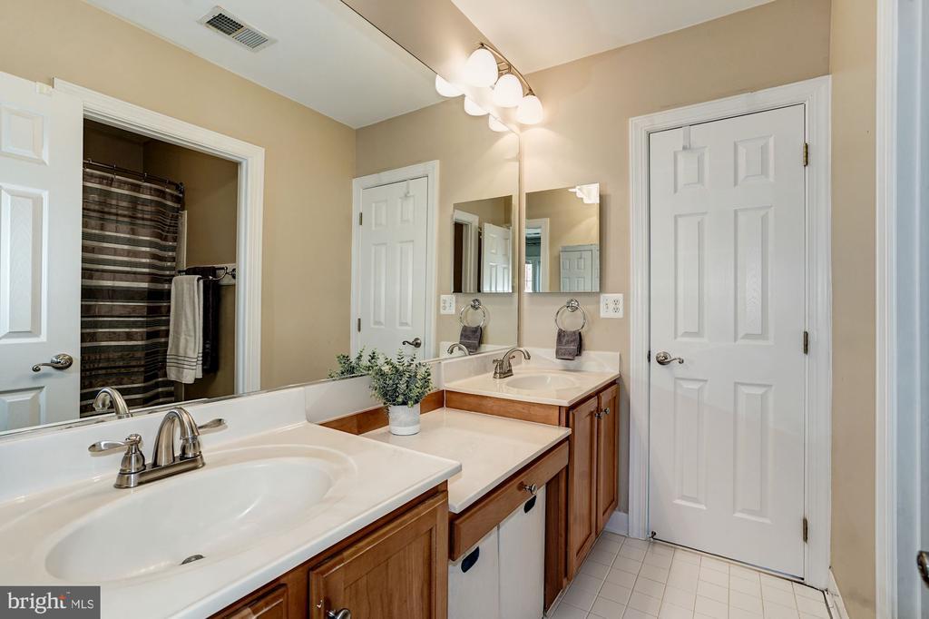 Add'l view of Jack-n-Jill bath w/ double vanity - 1309 SHAKER WOODS RD, HERNDON
