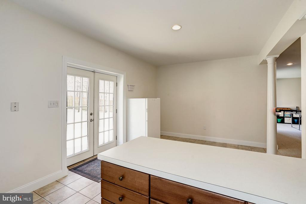 French door opens to the fully fenced backyard - 1309 SHAKER WOODS RD, HERNDON