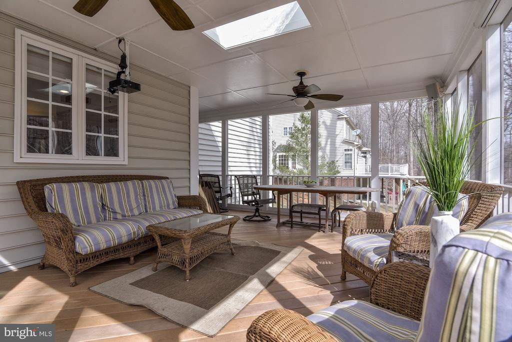 Private porch facing trees - 718 TURTLE POND LN, GAITHERSBURG