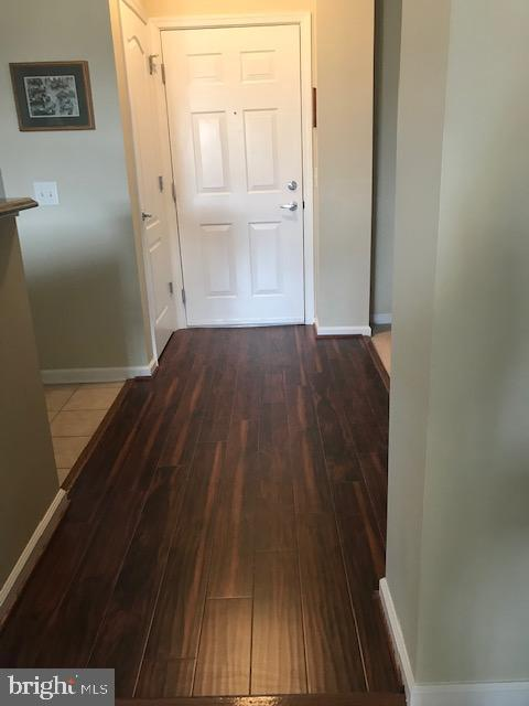 Rich new laminate flooring in front foyer - 815 BRANCH DR #405, HERNDON