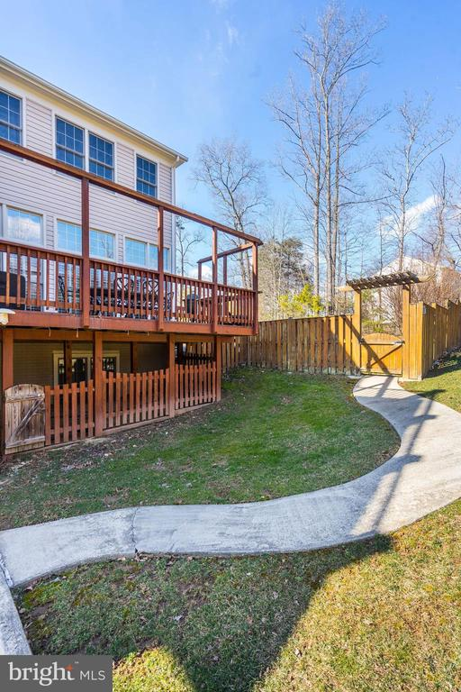 Walkway leading from the patio to the fence gate - 1309 SHAKER WOODS RD, HERNDON